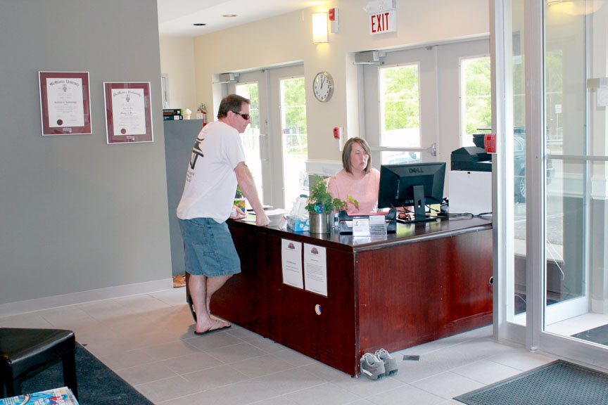 Tammy greeting patients at reception